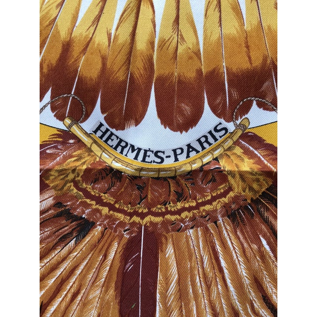 Luxurious silk scarf from Hermes in vibrant colors of rust, orange and yellow. This piece would be gorgeous framed as...