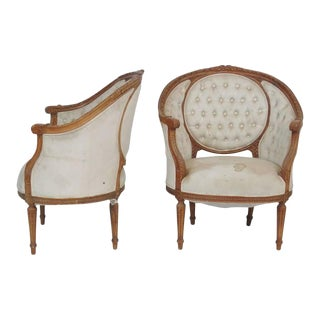 Louis XVI Style Carved Walnut Bergere Chairs - A Pair