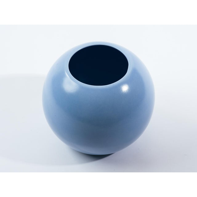 French Art Deco pale blue ceramic sphere vase. Signed and numbered on bottom, St. Clement, France 9255.