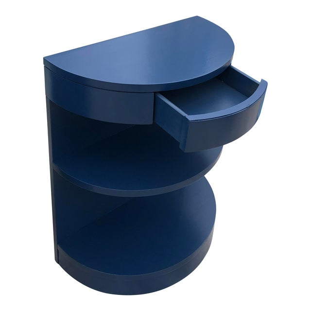 These are rare Mid Century side tables that have been refinished in a dark blue lacquer. Half round shaped with drawers...