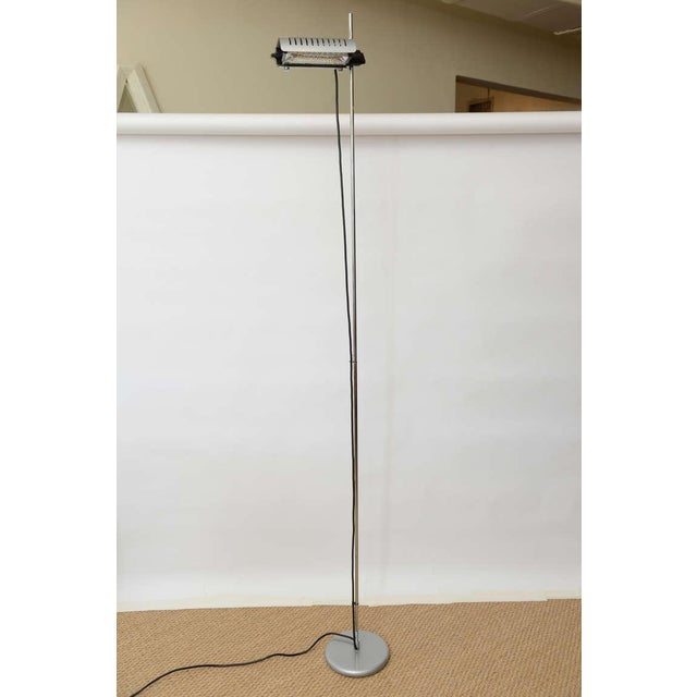 This very high style Italian Joe Colombo design for Oluce called the Alogena is an adjustable height and pivot floor lamp....