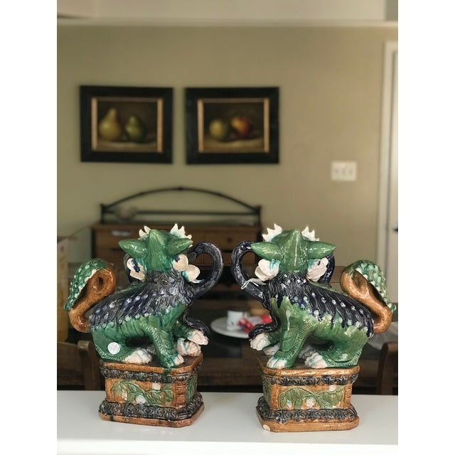 The foo dog symbolizes prosperity and success and guardianship. These rare Qing Dynasty pair of Foo Dogs are a fine...