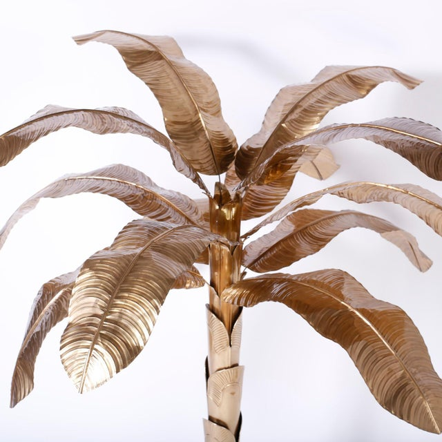 Chic midcentury stylized brass palm or banana tree with dramatic decorative appeal, removable leaves, layered sheath trunk...