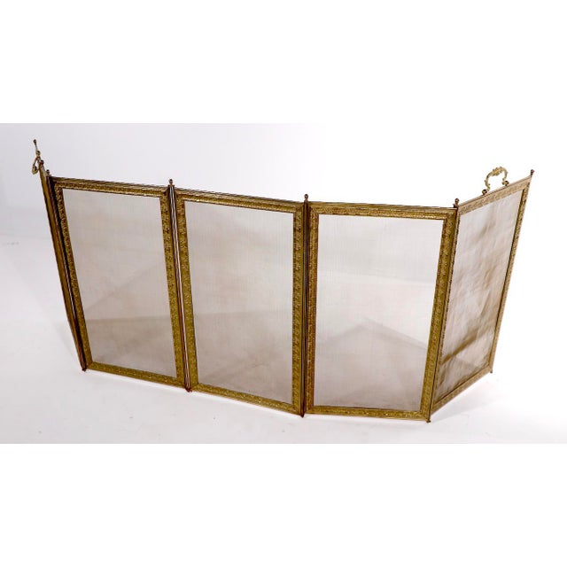 Unusual 5 fold fireplace screen, having a decorative embossed brass frame, with fine brass mesh screen. Each panel is...