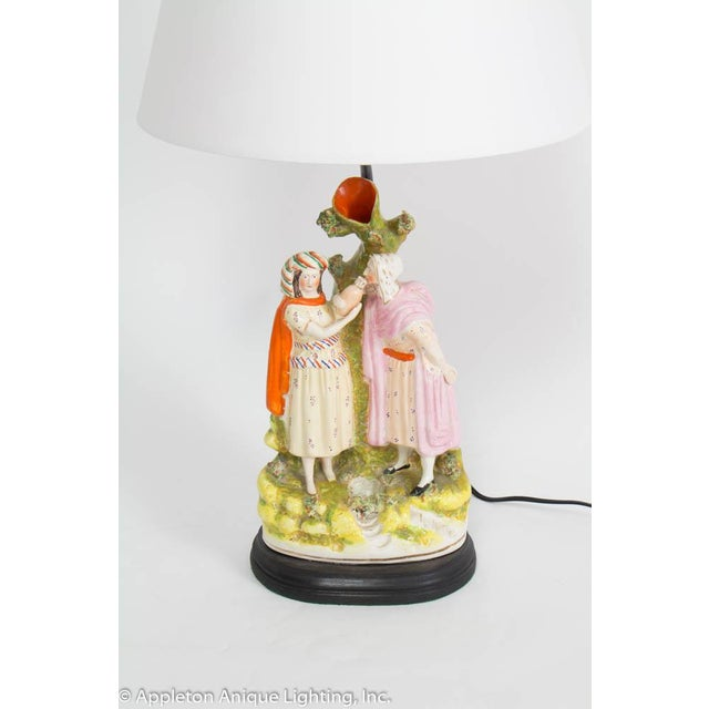 Staffordshire Table Lamp. Rich Colors. Figure of Rebekah and Abraham's servant at the well. Includes white paper shade