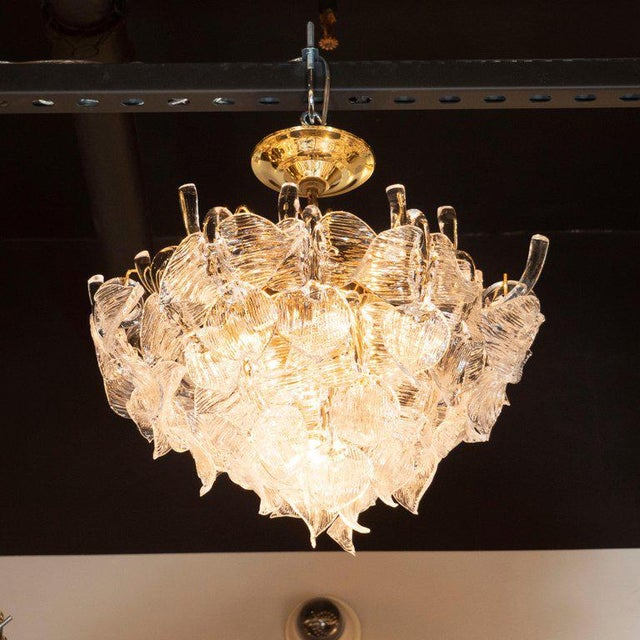 This glamorous chandelier was realized by the celebrated Mid Century Italian lighting studio, Camer, in Italy circa 1970....