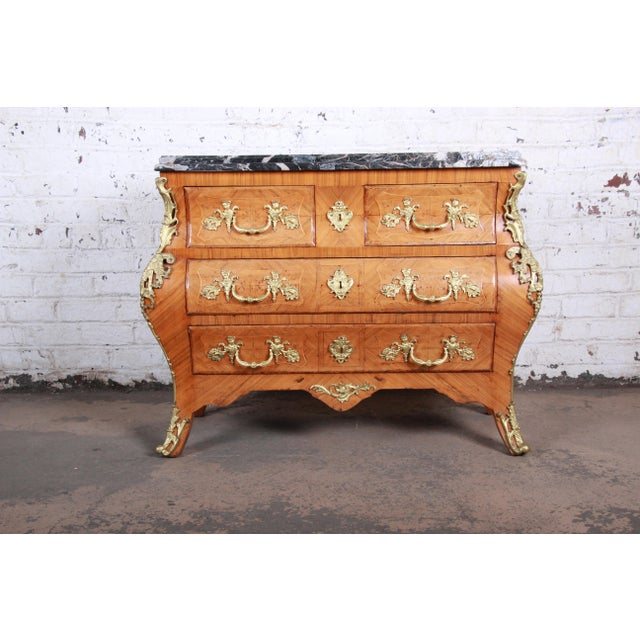An exceptional French Louis XV style mahogany bombay chest or commode. The chest features stunning mahogany wood grain...