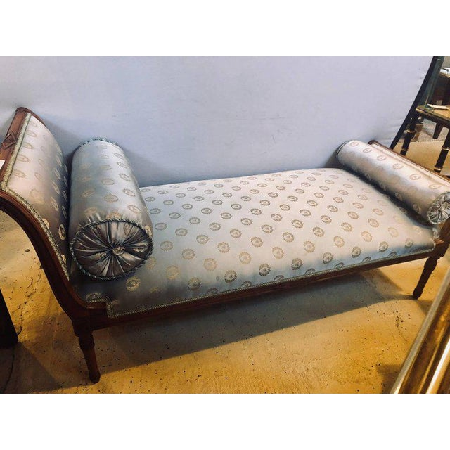 A fine Louis XVI style chaise longue in celeste blue upholstery with a sleigh form carved frame in a silk upholstery. This...