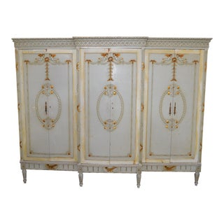 1920s Antique French Triple-Wide Knockdown Wardrobe With Gilded Cherubs For Sale