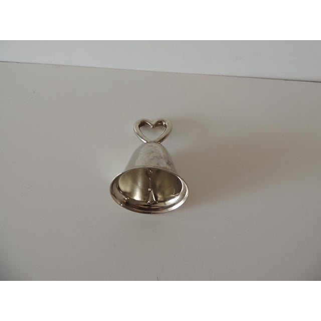 Boho Chic Polished Chrome Table Bell With Inscription and a Heart For Sale - Image 3 of 5