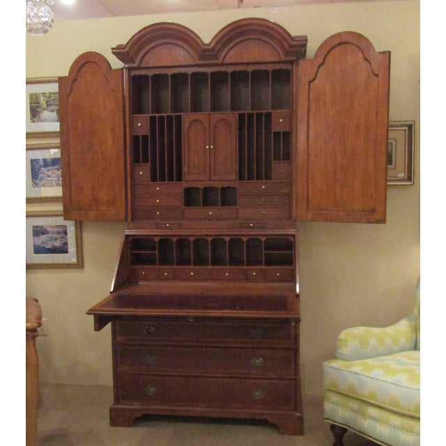 Grand secretaire with elegance and purpose. The doors open to expose multiple storage spaces, slots and drawers. The slant...