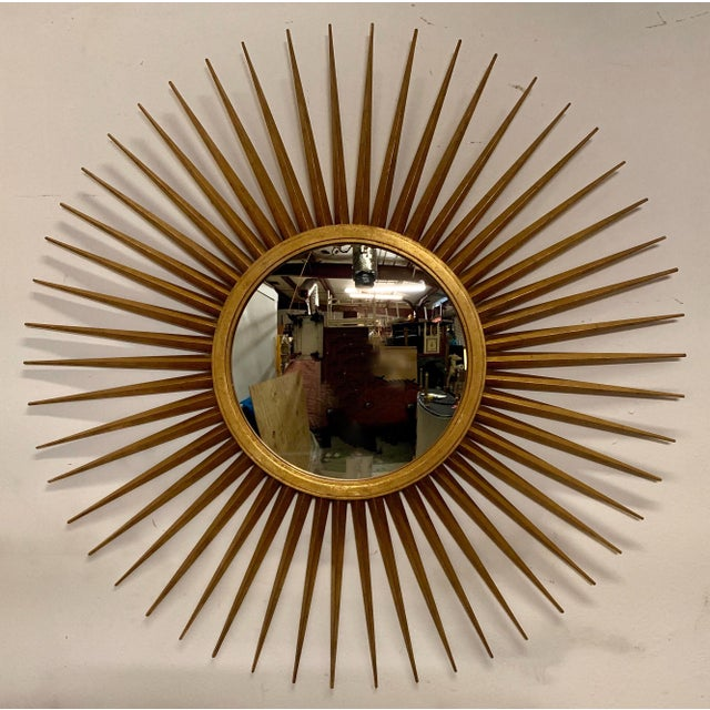 This is a rare find! It is large scale giltwood sunburst mirror designed by Parrish-Hadley for Baker Furniture. It is in...