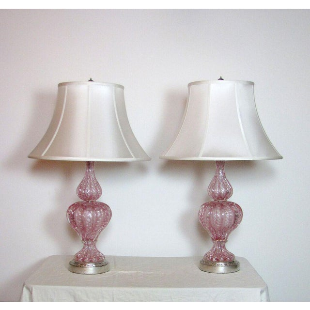 Pair of pink Murano blown glass lamps with silver leaf flecking and silver leaf bases. Italian, C. 1940. Completely...