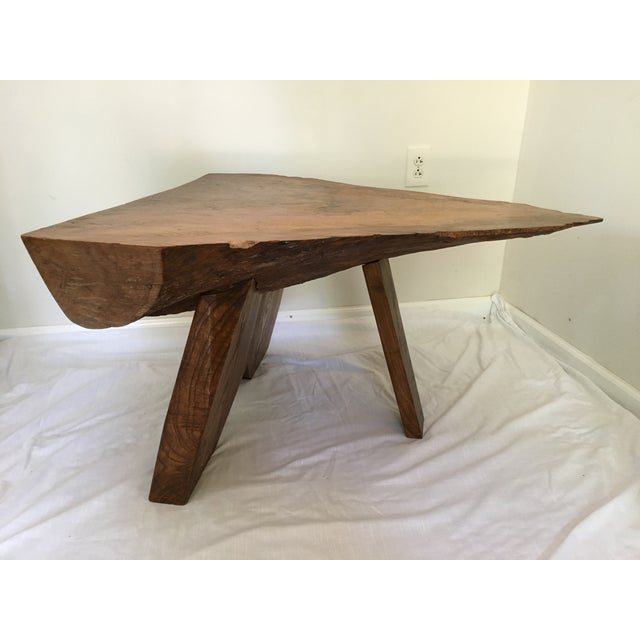 One of a kind live edge tree table, signed by artist, Treplow. Very heavy, sturdy, solid piece.