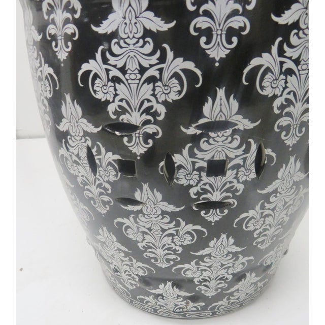 Chinese design porcelain garden stool, black base color with silver scroll and leaf designs. I have 3 available