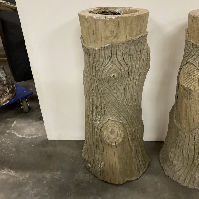 Nice pair of concrete faux bois planters from France.