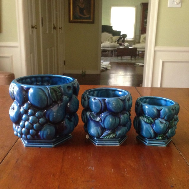 """A set of three Inarco """"Mood Indigo Blue"""" ceramic planters/Vases. These Vintage pieces feature a raised fruit pattern in..."""