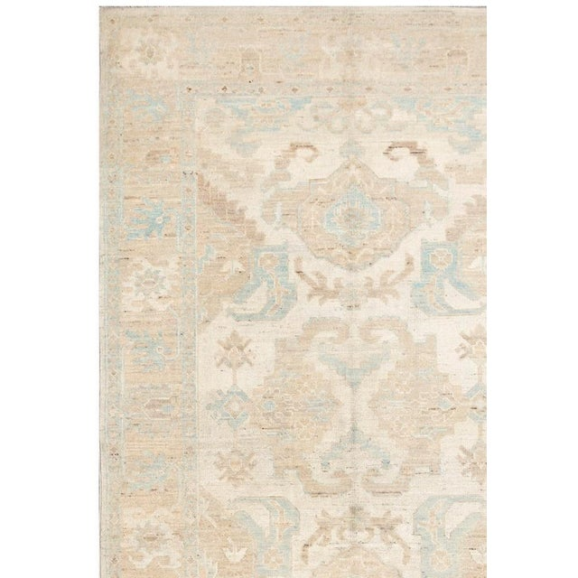 Hand knotted Khotan rug. 100% hand-spun lamb's wool with all natural dyes. From Pakistan.