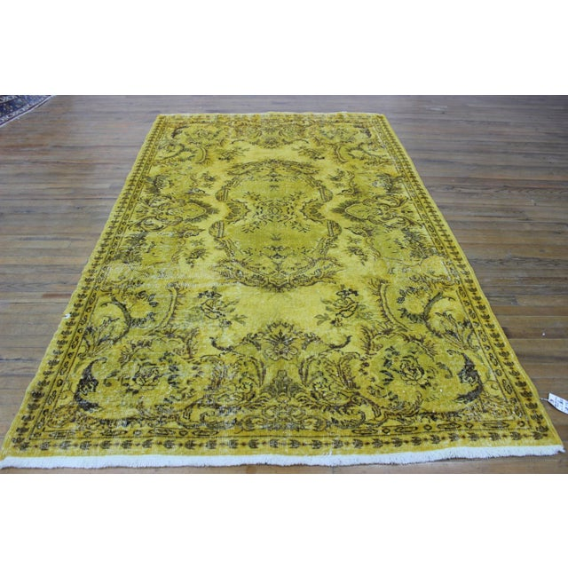 Hand-woven over-dyed vintage rug in yellow. Turkey (Anatolia) is one of main areas of carpets and kilim production on the...