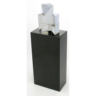 Chrome Cubist Sculpture on Black Granite Pedestal Preview