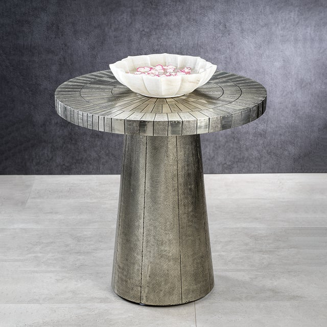 A clean and modern drinks table made from metal with textured & smooth details. The perfect spot for coffee or cocktails....