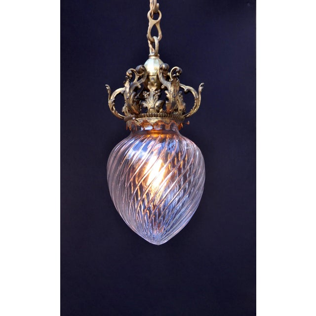 We could not resist this fine cut crystal pendant topped with an intricate bronze crown, (adjustable chain) probably added...