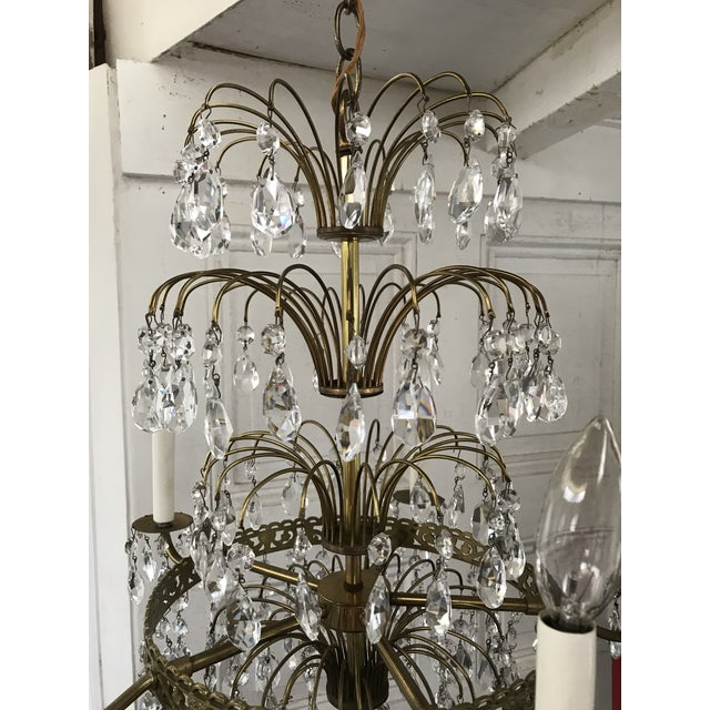Offered for sale is this original 1940s Baltic style bronzed brass chandelier. crystal layered design. Four lights ,...