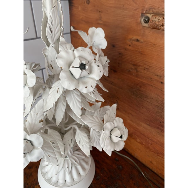 This is a beautiful mid century modern Italian tole floral lamp that has been painted white and shows with some flecks of...