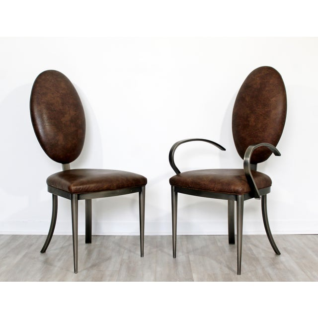 For your consideration is a special set of eight, brown leather and aluminum, dining chairs, including six side and two...
