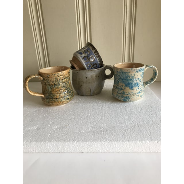 Set of four eclectic pottery vintage mugs or cups in soft earthy colors and shapes. Fun for everyday or setting the table...