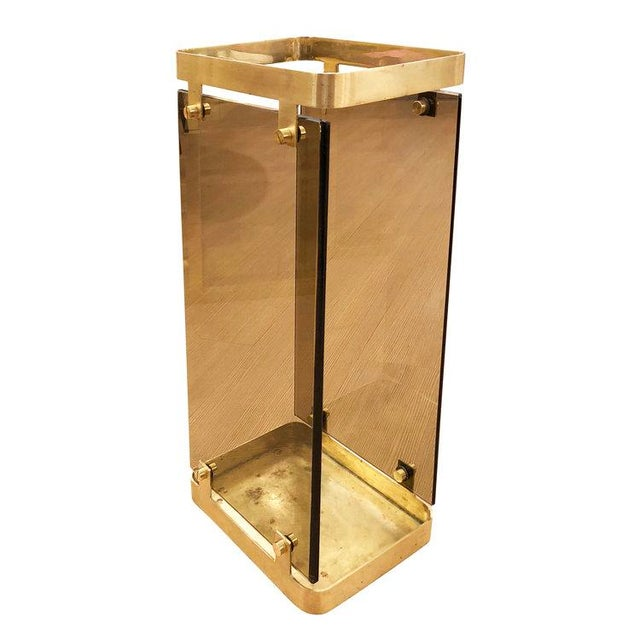 Refined 1960's Fontana Arte umbrella stand composed of two beveled smoked glasses mounted on brushed brass frame.