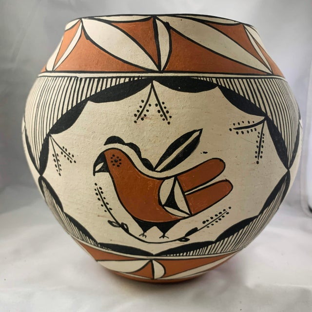 Acoma Pueblo Polychrome Olla featuring parrot decoration and rain motifs, signed DA Acoma NM. Design incorporates parrots...