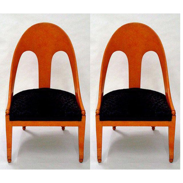 A pair of neoclassic spoonback chairs in tangerine faux marble finish and black leopard print upholstery by Michael Taylor...