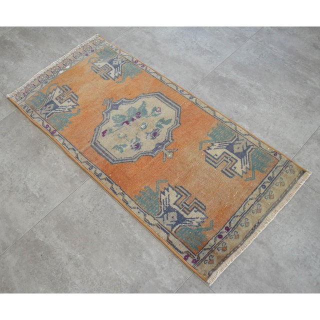 Vintage brunt orange background color yastik rug perfect for a small guest bath or in front of the kitchen sink...