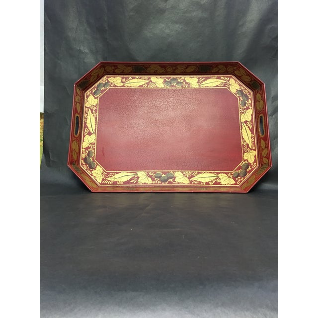 """Vintage Red tole tray with gold stenciled design. This tray has a textured """"gator"""" surface as shown in the photos. There a..."""