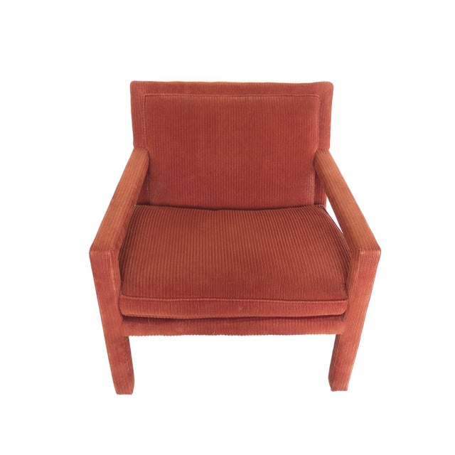 This outstanding pair of armchairs is rich in color and texture. They are completely covered in a carmine-orange corduroy...