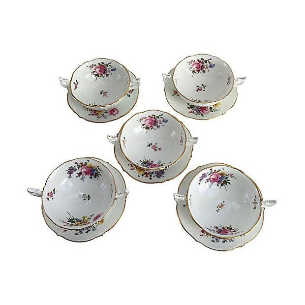 Set of five Cauldon porcelain soup bowls and underplates elegantly decorated with floral motifs and gold rims. Perfect for...