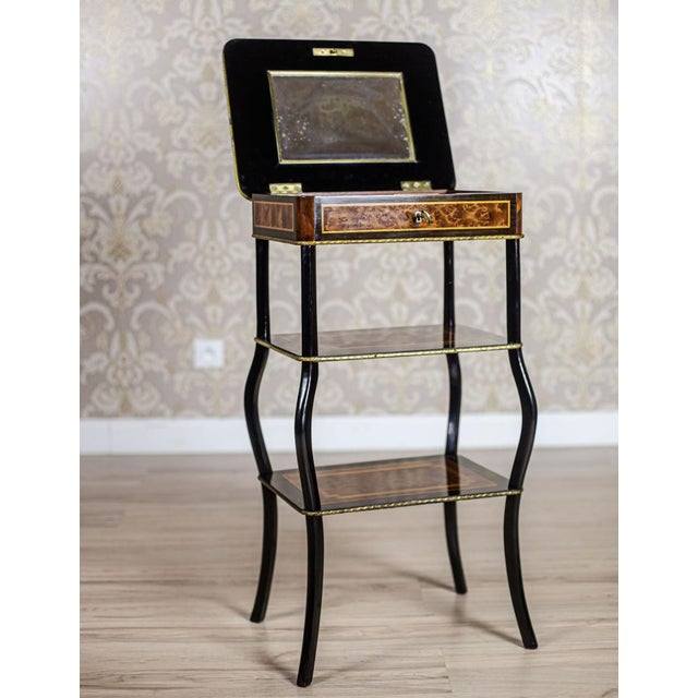 We present you a three-tier antique whatnot on bent legs, with a compartment opened from the top. The inside of the...