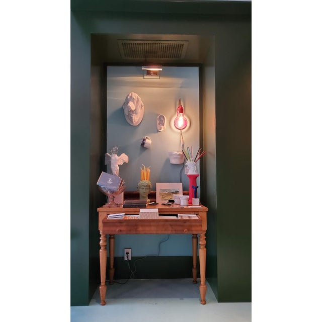 This is a fun light with a contemporary flair. It has the sophistication to be in a new contemporary space, but fun enough...