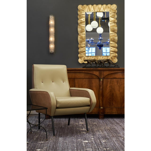 Murano glass gold leaf mirror featuring a solid gilt brass frame supporting stamped glass elements backed by 23 carat gold...