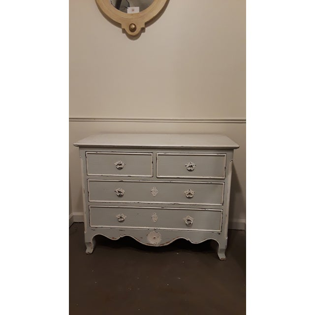 Four drawer blue and white painted French chest of drawers/commode. Features bail pulls with decorative escutcheon plates...