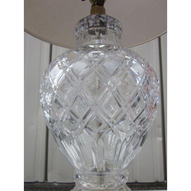 "Stunning pair of cut crystal table lamps with brass decorative bases. Measures: 29""H (to top of finial) x 9"" in diameter...."