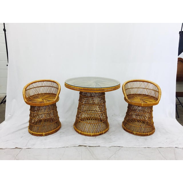 Vintage Mid Century Era Woven Wicker Bistro Set Complete with 2 Honeymoon or Peacock Style Chairs. Protective Round Glass...