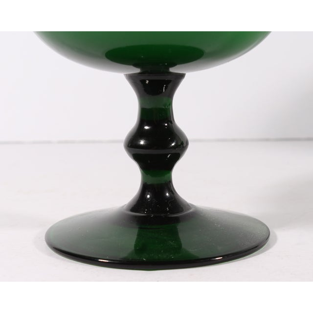 A set of four champagne coupes or sherbet glasses by Carlo Moretti. Made in Italy, these mid-century glasses are green...