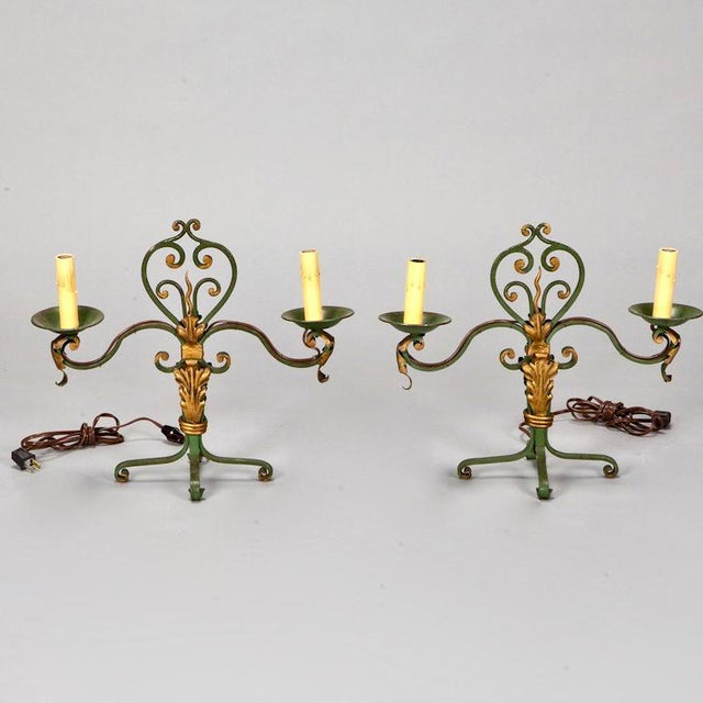 Charming pair of 1930's French green and gilt scroll metal two light table lamps with accents of acanthus. Excellent...