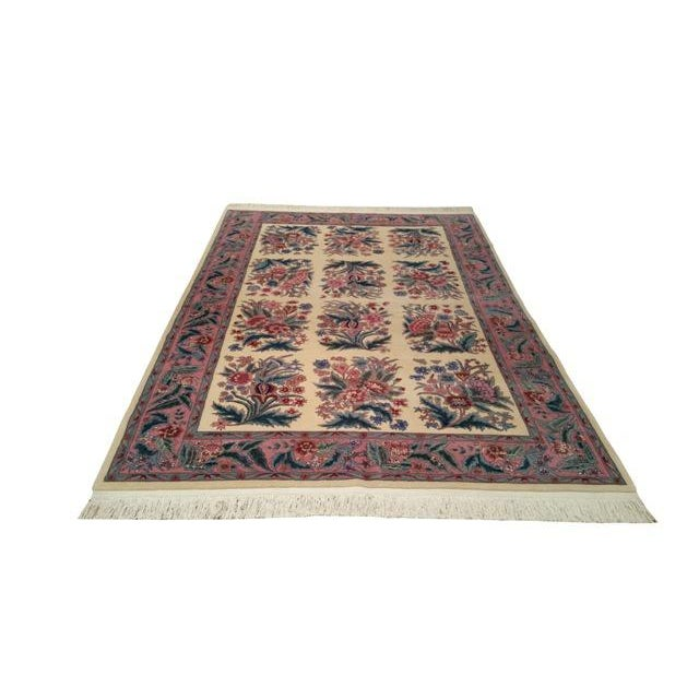 Infuse a touch of beauty to high-traffic areas of your home with this durable traditional rug in colors of pink, green,...