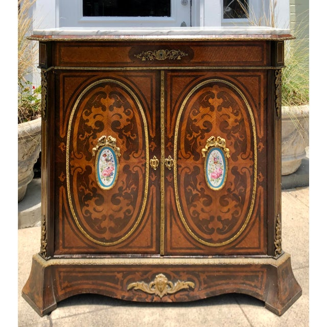 Antique 19C Dutch Marquetry Inlaid Marble Top Buffet Cabinet w German Porcelain Medallions. Velvet lined interior and gilt...