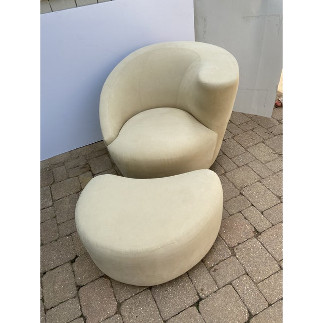 A set of single swivel club chair and ottoman labeled Weiman in the style of Vladimir Kagan Nautilus style. The set is...