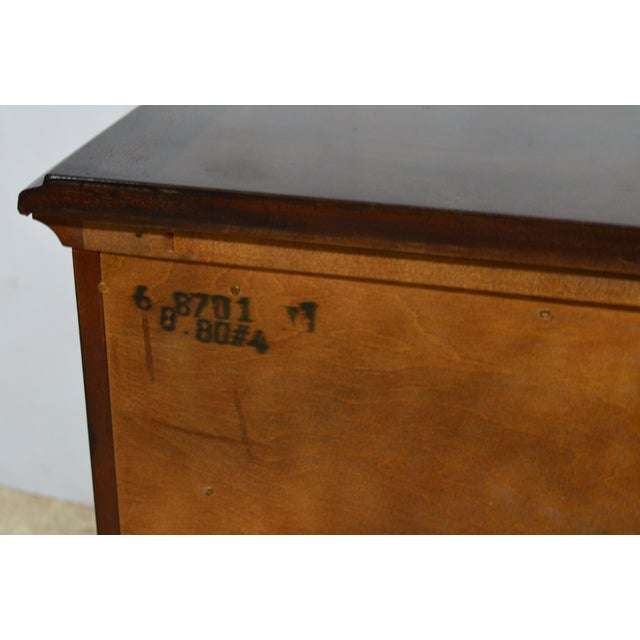 Solid mahogany nightstands made by Henredon Furniture. It features three dovetailed drawers, bracket feet and brass hardware.