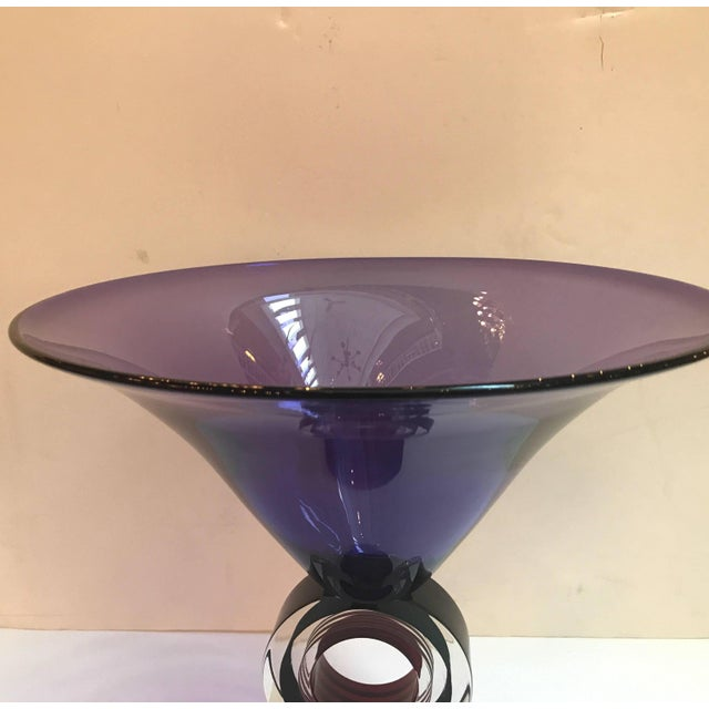A tall modern trumpet form center bowl with unusual pedestal base. The base with a circular stem with bands of colored...